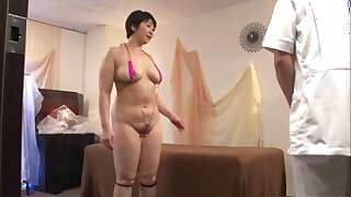 Oiled Japanese MILF Yagi Michika gets massaged and fucked on the bed
